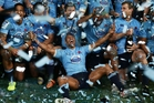 Kurtley Beale (centre) and the Waratahs celebrate victory in the Super Rugby final at ANZ Stadium on Saturday night. Photo / Getty Images