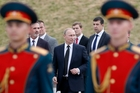 Vladimir Putin is captive to the chauvinist fever he has stoked in Russia. Photo / AP