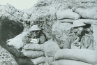 New Zealand soldiers wear gas masks during a gas alert at Ypres Salient in 1917.