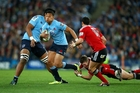 Israel Folau runs the ball up for the Waratahs last night. Photo / Getty Images
