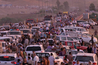 Iraqi people from the Yazidi community arriving in Irbil in northern Iraq after Islamic militants attacked the towns of Sinjar and Zunmar. Photo / AP