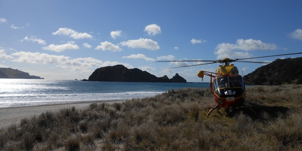 The rescue helicopter at Harataonga Bay today. Photo / Auckland Westpac Rescue Helicopter