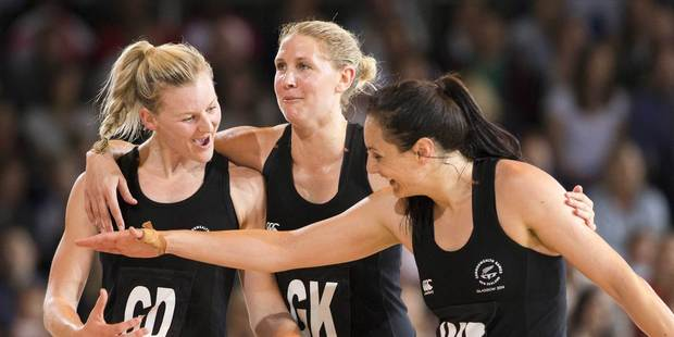 From left to right, New Zealand's Katrina Grant, Casey Kopua and Joline Henry celebrate New Zealand's win over Engand in Glasgow. Photo / Greg Bowker