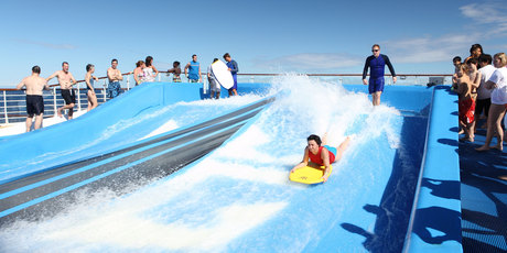 The Voyager of the Seas 'flowrider' surfing simulator.
