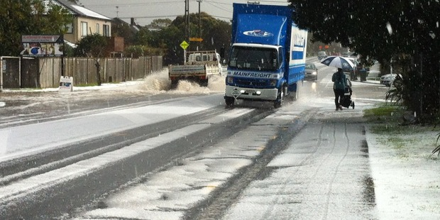 Marua Road in Ellerslie was covered in hail, with surface flooding quickly building up. Photo / Richard Kerry
