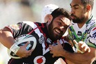 Konrad Hurrell of the Warriors is tackled during the round 21 NRL match between the Canberra Raiders and the New Zealand Warriors at GIO Stadium. Photo / Getty Images.