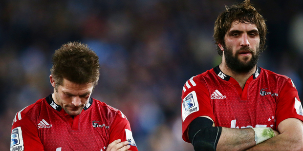 Richie McCaw and Samuel Whitelock look dejected after the Super Rugby final match between the Waratahs and the Crusaders. Photo / Getty Images