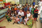 Michael Galvin and Ria Vandervis with a class from Dilkusha Girls School in Fiji. Photo / Jae Frew