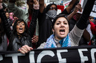 Demonstrators march down Auckland's Queen St to protest Israeli aggression in Gaza and Palestine. Photo / Michael Craig