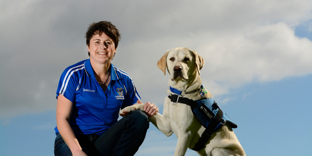 Wendy Isaacs and her puppy Logan - 8 months. Logan will be trained as a dog for the Assistance Dogs Trust. PHOTO/GEORGE NOVAK