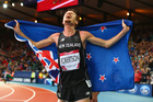 Zane Robertson celebrates after winning bronze in the Men's 5000 metres final at Hampden Park Stadium during day four of the Glasgow 2014 Commonwealth Games. Photo / Getty Images