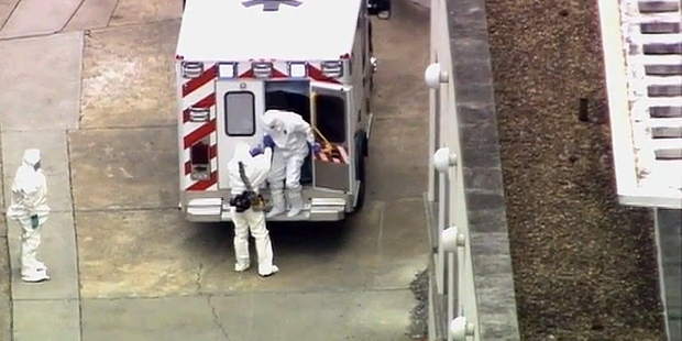 An ambulance arrives with Ebola victim Dr. Kent Brantly, right, to Emory University Hospital. Photo / AP