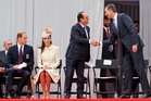 The Duke and Duchess of Cambridge, left, look on as French President Francois Hollande greets Spain's King Felipe, right, ahead of the 100th Anniversary of the outbreak of WWI in Liege, Belgium. Photo / AP