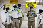 Nigeria health officials wait to screen passengers at the arrival hall of Murtala Muhammed International Airport in Lagos, Nigeria. Photo / AP