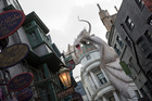 A dragon sits atop Gringotts Bank in Diagon Alley in The Wizarding World of Harry Potter, Orlando. Photo / AP