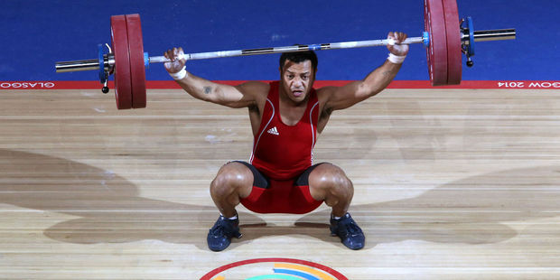 In this image taken Sunday July 27 Papua New Guinea's Toua Udia competes in the Clean and Jerk of the men's 77kg Weightlifting in Glasgow. Photo / AP