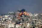 Smoke and fire from the explosion of an Israeli strike rise over Gaza City. Photo / AP