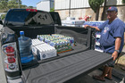 Honolulu resident Stan Nuuhiwa fills his truck with cases of water. Hawaii is bracing for two back to back hurricanes, Iselle and Julio. Photo / AP