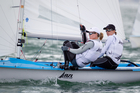 Skipper Jo Aleh and crew Polly Powrie roll tacks on the last day of the Oceanbridge Sail Auckland Regatta in the 470 class. Photo / Richard Robinson.