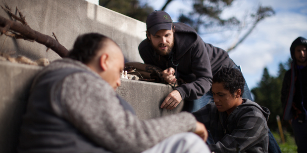 James Napier Robertson (above) with Cliff Curtis and James Rolleston on the set of The Dark Horse.  Photo / Supplied