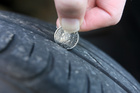 A 20-cent coin is a good way to check tyre tread depth. If you can see the '20', it's time to think about replacement. Photo / Lynda Feringa