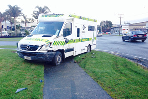 One of the ambulances in yesterday's crash skidded to a stop on a grassy back on the corner of Rewarewa Rd and Te Waiti Pl. PHOTO/ HANNAH NORTON