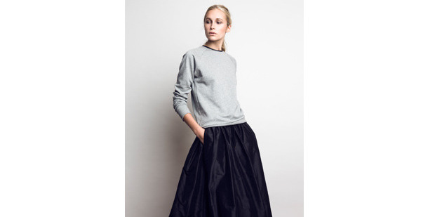 Juliette Hogan grey marle sweater, $249, and raw silk skirt $699. Picture / Supplied.