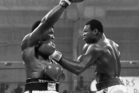 Larry Holmes did most of his damage with his left, on display here against Trevor Berbick. Photo / AP