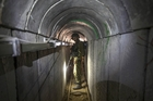 An Israeli army officer inspects a tunnel allegedly used by Palestinian militants. Picture / AP