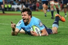 A jubilant Adam Ashley-Cooper celebrates one of his two tries which helped guide the Waratahs to the nail-biting win. Photo / Getty Images