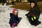Mackenzie Rielly-Milne and Max Colville playing with the snow. Photo / Malcolm Pullman
