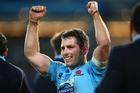 Bernard Foley celebrates after the Waratahs beat the Crusaders in the Super Rugby final. Photo / Getty Images