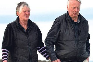 Pam and Paddy Paterson enjoy a walk on the beach at Kaka Point yesterday. Photo / Peter McIntosh