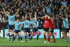 The jubilant Waratahs celebrate their first Super Rugby title. Photo / Getty Images