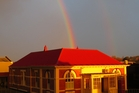 The Dannevirke Gallery of History glistens in the early morning sunlight, with a rainbow behind. Photo / Tony Clark