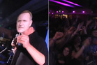 Stills from the video posted by the Internet-Mana party showing the crowd in a frenzy by Dotcom, left, holding a cut-out mask of John Key.
