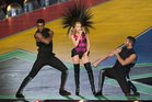 Kylie Minogue entertains athletes at the closing ceremony at Hampden Park. Photo / Greg Bowker