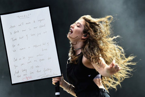 Lyrics to the chorus of Royals were written out by Lorde and signed by her and the song's producer, Joel Little. Photo/Getty