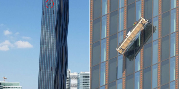Rough day on the job. Two workers had a lucky escape when their window-cleaning cradle slipped on Austria's DC Tower. Photo / Getty Images
