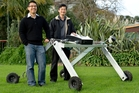 Chee Kit Wong (left)  and Patrick Lim demonstrate an experimental robot platform for agriculture.