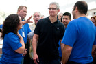 Apple store employees greet CEO Tim Cook at a new Apple Store in California. Photo / Getty