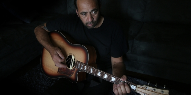 SINGING THE BLUES: Local roofer Grant Haua has the voice of a true bluesman. He is one of two-piece grass roots blues band Swamp Thing. PHOTO/JOHN BORREN