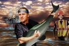 John Key playing guitar with a Maui's dolphin in Planet Key.