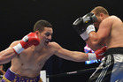 Kiwi Joseph Parker, left, beat Keith Thompson in round 3. Photo / Getty Images