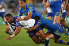 Tony Williams of the Bulldogs is tackled during the round 23 NRL match between the Parramatta Eels and the Canterbury Bulldogs. Photo / Getty Images