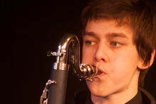 A bass clarinet player of the Strathallan College Jazz Band from South Auckland plays a solo piece during one of the band's performances. Photo / Donna Russell