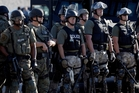 Images of armed police officers in Ferguson have alarmed people across the United States. Photo / AP