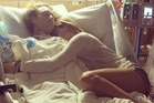 In this Instagram post, Brad Smeele is pictured in hospital with his girlfriend Talor Reazin.