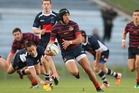 Rotorua Boys' High School and Tauranga Boys' College will do battle this weekend. Pictured, with ball, is Boys' High first XV player Ngarohi McGarvey-Black playing earlier this season. Photo / Ben Fraser