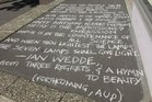 An Ian Wedde poem written in chalk on a city footpath for National Poetry Day in 2010.